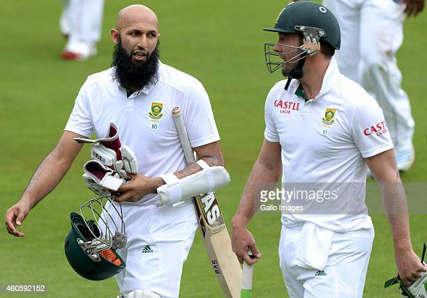 Hashim Amla and AB de Villiers walk off for tea during day 1 of the 1st Test match between South Africa and West Indies at SuperSport Park on...