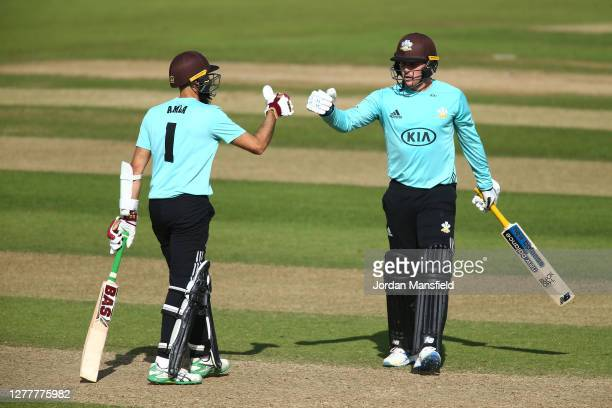 Hashim Amla and Jason Roy of Surrey punch gloves during the T20 Vitality Blast Quarter Final match between Surrey and Kent at The Kia Oval on October...