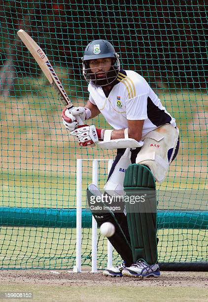 Hashim Amla bats during the South African national cricket team nets session and press conference at Claremont Cricket Club on January 17 2013 in...