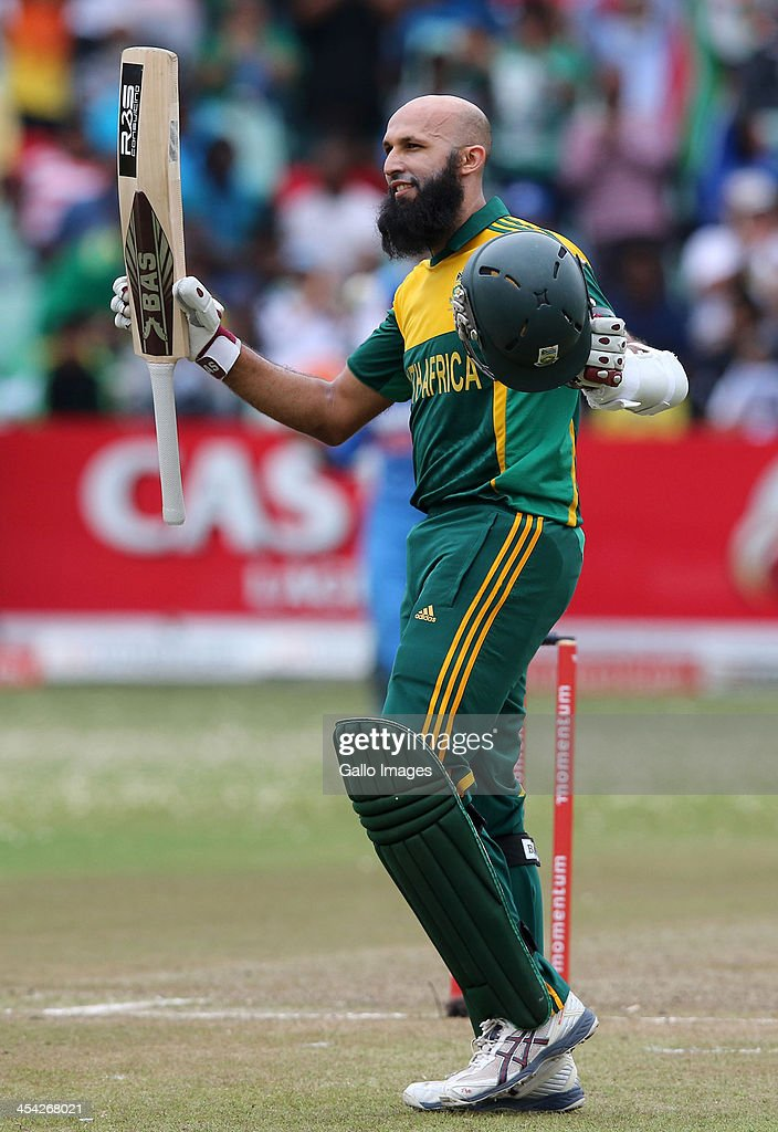 Hashim Amla gets 100 runs during the 2nd Momentum ODI match between South Africa and India at Sahara Stadium Kingsmead on December 08, 2013 in Durban, South Africa.