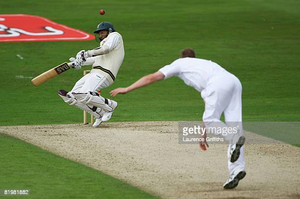 Hashim Amla of South Africa avoids a bouncer from Andrew Flintoff of England during day one of the Second Test match between England and South Africa...