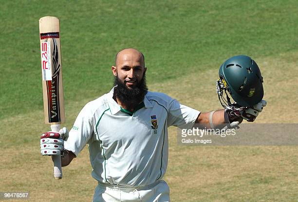 Hashim Amla of South Africa celebrates his 200 runs during day two of the First Test match between India and South Africa at the Vidarbha Cricket...