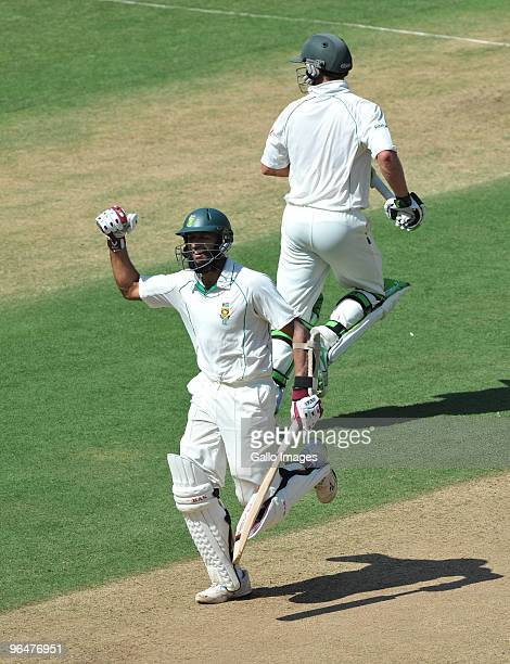 Hashim Amla of South Africa celebrates his 200 runs with AB de Villiers during day two of the First Test match between India and South Africa at the...