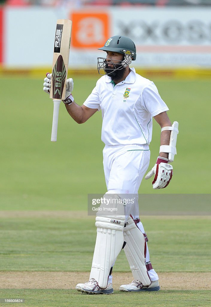 Hashim Amla of South Africa celebrates his 50 during day one of the second test match between South Africa and New Zealand at Axxess St Georges on January 11, 2013 in Port Elizabeth, South Africa.