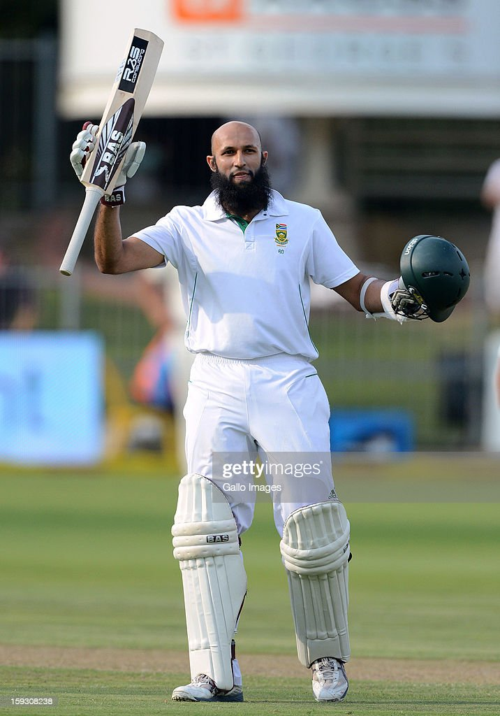 Hashim Amla of South Africa celebrates his century during day one of the second test match between South Africa and New Zealand at Axxess St Georges on January 11, 2013 in Port Elizabeth, South Africa.