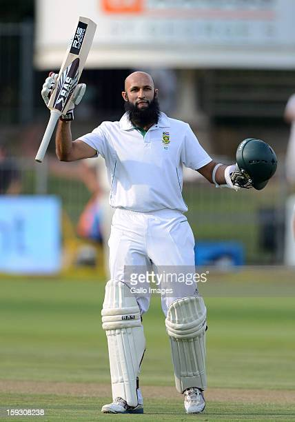 Hashim Amla of South Africa celebrates his century during day one of the second test match between South Africa and New Zealand at Axxess St Georges...