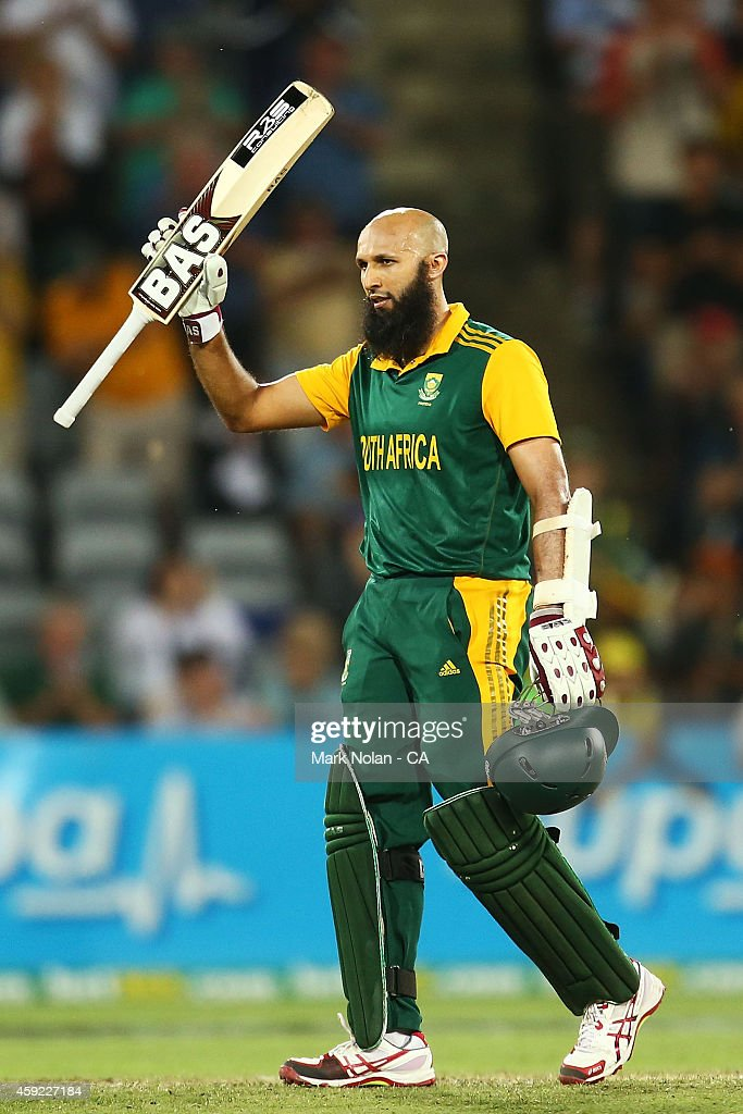 Hashim Amla of South Africa celebrates his century during game three of the One Day International Series between Australia and South Africa at Manuka Oval on November 19, 2014 in Canberra, Australia.