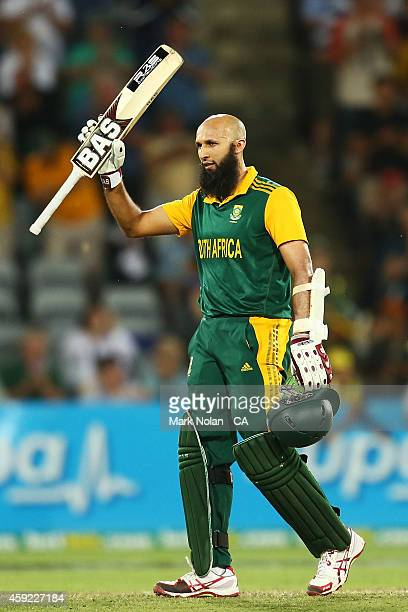 Hashim Amla of South Africa celebrates his century during game three of the One Day International Series between Australia and South Africa at Manuka...