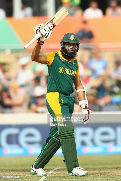 Hashim Amla of South Africa celebrates his century during the 2015 ICC Cricket World Cup match between South Africa and Ireland at Manuka Oval on...