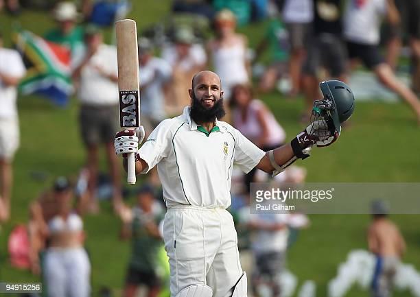 Hashim Amla of South Africa celebrates making a century during day four of the first test match between South Africa and England at Centurion Park on...