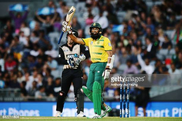 Hashim Amla of South Africa celebrates scoring a half century during the first International Twenty20 match between New Zealand and South Africa at...