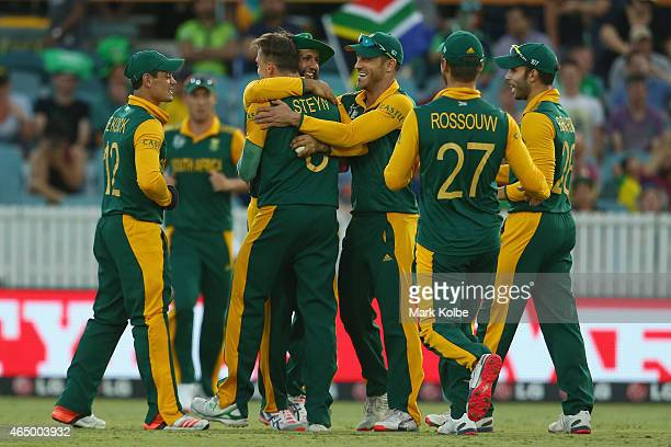 Hashim Amla of South Africa celebrates with Dale Steyn of South Africa after he took the wicket of Ed Joyce of Ireland during the 2015 ICC Cricket...