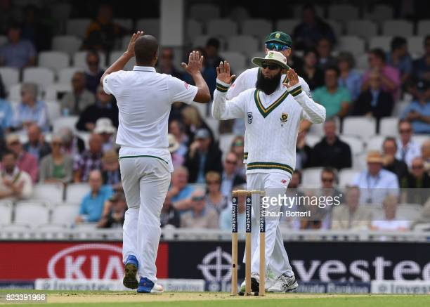 Hashim Amla of South Africa congratulates Vernon Philander during the 3rd Investec Test match between England and South Africa at The Kia Oval on...