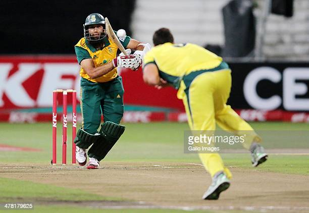 Hashim Amla of South Africa is caught and bowled by Nathan CoulterNile of Australia during the 2nd T20 International match between South Africa and...