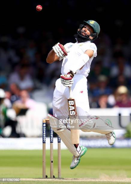 Hashim Amla of South Africa is hit by a bouncer bowled by James Anderson on day four of the 1st Investec Test match between England and South Africa...