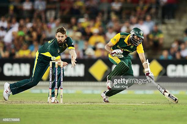 Hashim Amla of South Africa makes the crease as Kane Richardson of Australia fields during game three of the One Day International Series between...