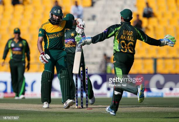 Hashim Amla of South Africa reacts after being dismissed by Pakistan bowler Mohammad Irfan during the third One Day International between Pakistan...