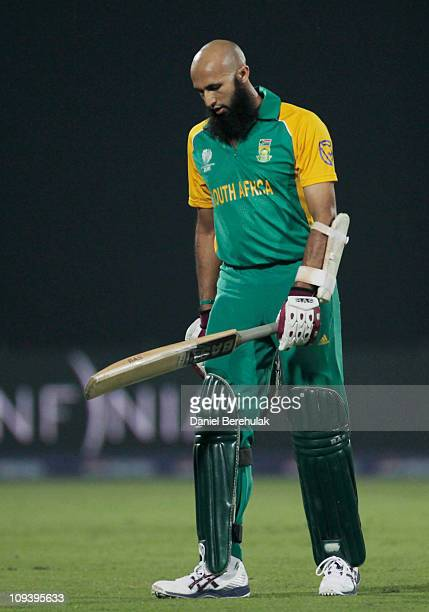 Hashim Amla of South Africa walks back to the pavillion after being dismissed by Kemar Roach of West Indies during the 2011 ICC World Cup Group B...