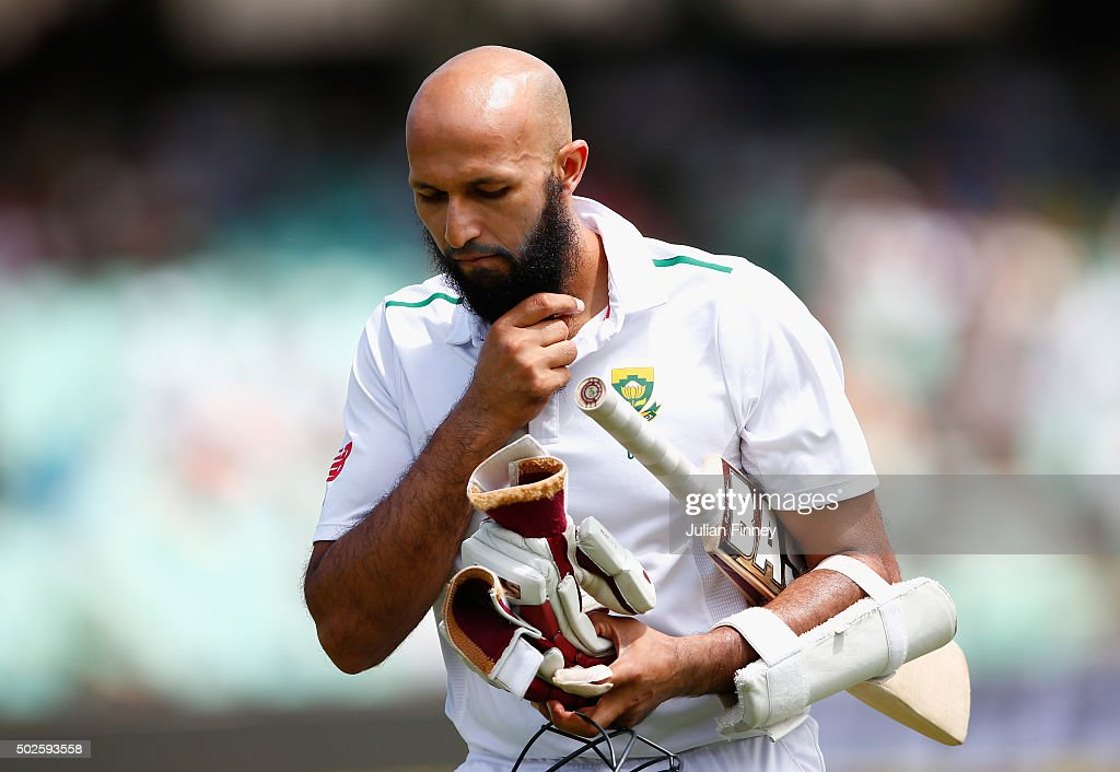 Hashim Amla of South Africa walks off after being caught behind during day two of the 1st Test between South Africa and England at Sahara Stadium Kingsmead on December 27, 2015 in Durban, South Africa.