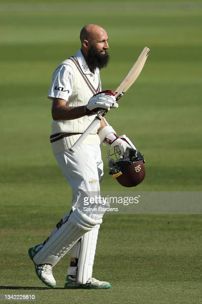 Hashim Amla of Surrey celebrates reaching his century on day four during the LV= Insurance County Championship match between Surrey and Glamorgan at...