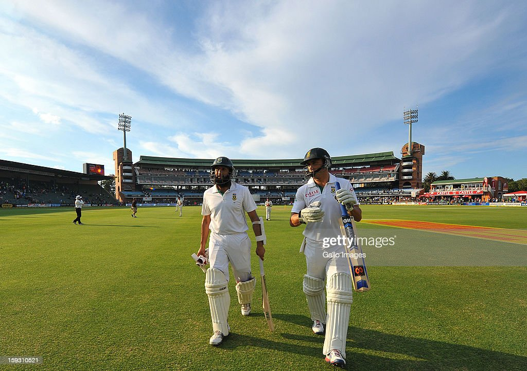 Hashim Amla on 105 and Faf du Plessis on 69 leave the field at the end of day one of the second test match between South Africa and New Zealand at Axxess St Georges on January 11, 2013 in Port Elizabeth, South Africa.