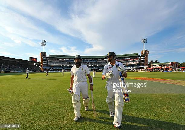 Hashim Amla on 105 and Faf du Plessis on 69 leave the field at the end of day one of the second test match between South Africa and New Zealand at...