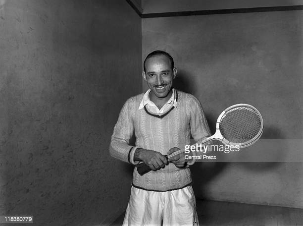 Hashim Khan, Pakistani squash player, poses holding two squash racquet during a practice session ahead of the Professional Squash Racquets...