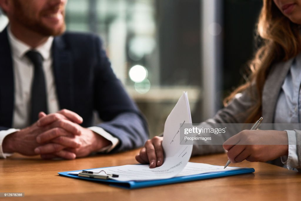 Hashing out the terms and conditions of the contract : Stock Photo