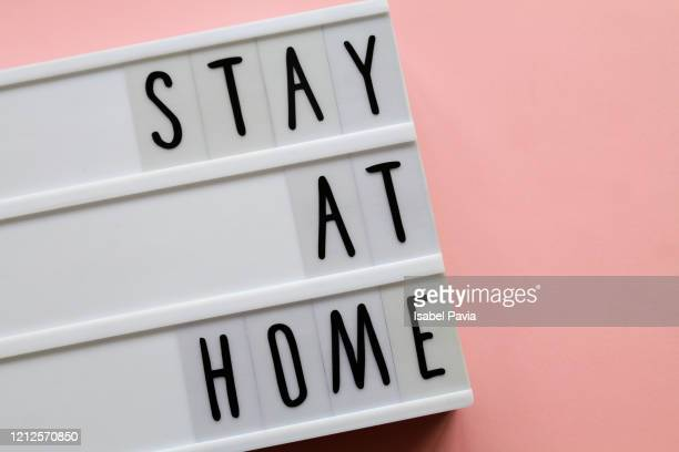 """""""STAY AT HOME"""" hashtag in light box"""