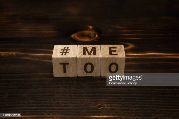hashtag me too words on wooden blocks - sexual violence stock pictures, royalty-free photos & images