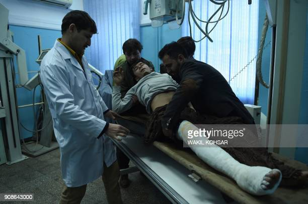 TOPSHOT Hasibullah a wounded employee of the Intercontinental Hotel gets an Xray scan at the Wazir Akbar Khan hospital in Kabul on January 22...