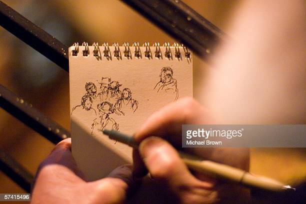 Hasidic artist Emanuel Meyerson draws a sketch of members of the Satmar Hassidic Jewish community who were filling up the nearby intersection of...