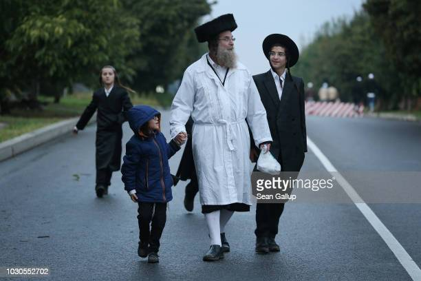 Hasidic Jew from Israel and members of his family arrive to perform tashlikh a Jewish atonement ritual at the bank of a lake formed by the Umanka...