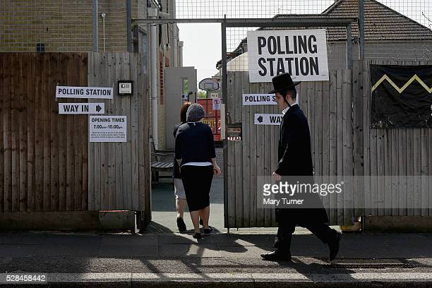 Hasidic Jews arrive at the Menorah Primary School in Golders Green North London to register their votes in the Mayoral and Assembly elections on May...