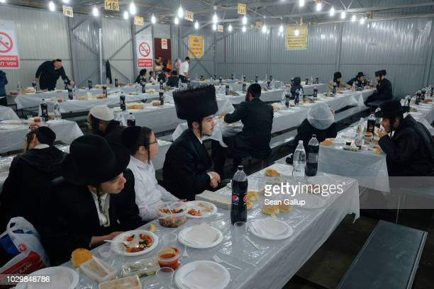 Hasidic Jews eat in a cafeteria that serves 15000 kosher meals twice a day for free prior to the annual Rosh Hashanah celebration on September 8 2018...