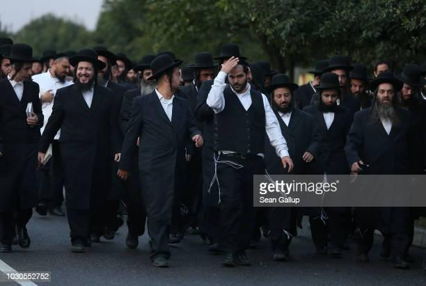 Hasidic Jews walk towards a lake to perform tashlikh a Jewish atonement ritual on the first day of Rosh Hashanah on September10 2018 in Uman Ukraine...