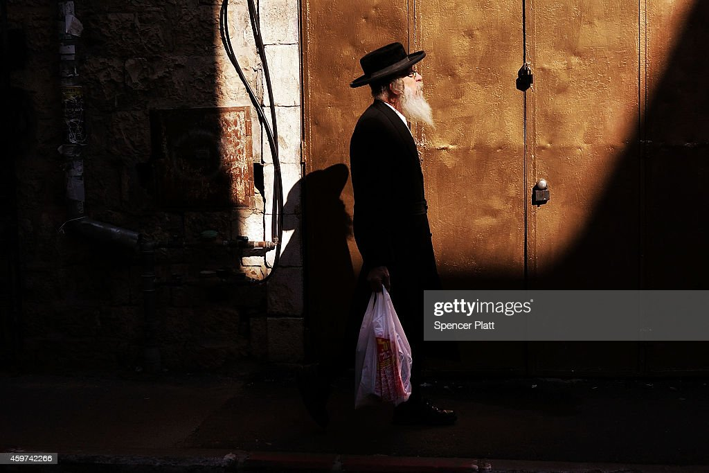 A Hasidic man is seen in an Orthodox neighborhood on November 30, 2014 in Jerusalem, Israel. Nine Israelis have been killed in a series of stabbings, shootings and hit-and-run attacks in Jerusalem over the past month, unsettling the ancient city of Jerusalem where Jews, Christians and Muslims have lived side by side for thousands of years. The tension and violence on the streets of the city is threatening to further isolate communities and encourage extremist politicians to exploit the situation.