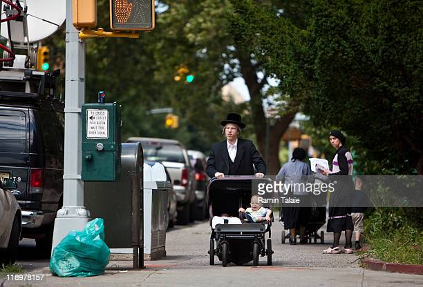 Hasidic man pushes a stroller near the residence of Leibby Kletzky a murdered eightyearold boy who went missing from the Hasidic neighborhood of...