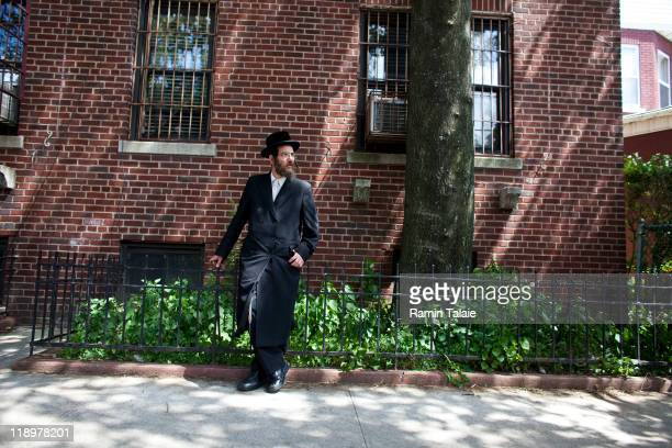 Hasidic man stands near the residence of Leibby Kletzky a murdered eightyearold boy who went missing from the Hasidic neighborhood of Borough Park...