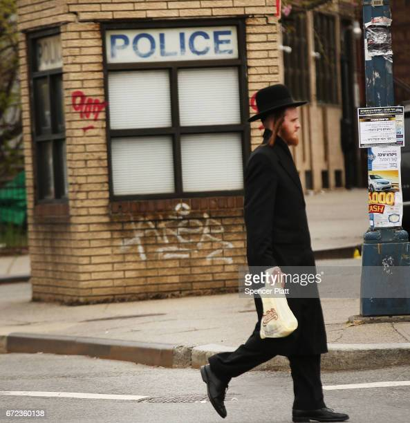 Hasidic man walks by a police outpost in a Jewish Orthodox neighborhood in Brooklyn on April 24 2017 in New York City According to a new report...