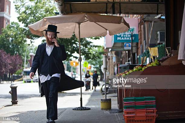 Hasidic man walks near the residence of Leibby Kletzky a murdered eightyearold boy who went missing from the Hasidic neighborhood of Borough Park...
