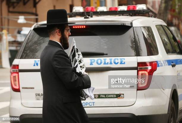 Hasidic man walks through a Jewish Orthodox neighborhood in Brooklyn on April 24 2017 in New York City According to a new report released by the...