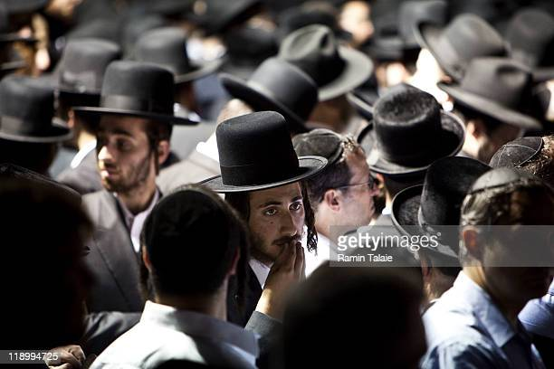 Hasidic men wait for a procession for the body of Leibby Kletzky a murdered eightyearold boy who went missing from the Hasidic neighborhood of...