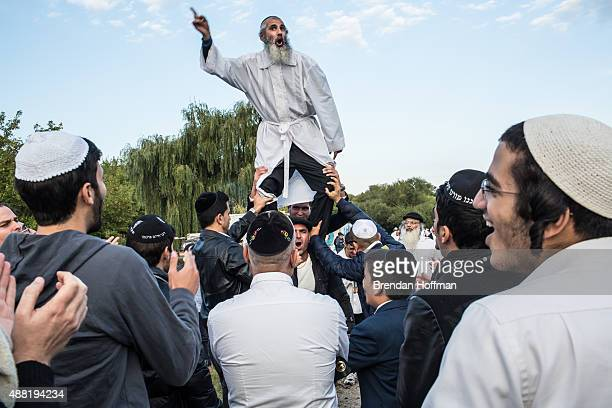 Hasidic pilgrims dance not far from the burial site of Rebbe Nachman of Breslov on September 14 2015 in Uman Ukraine Every year tens of thousands of...