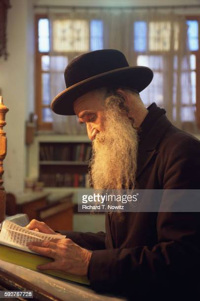 hasidic rabbi in ancient prayer house - rabbi stock pictures, royalty-free photos & images