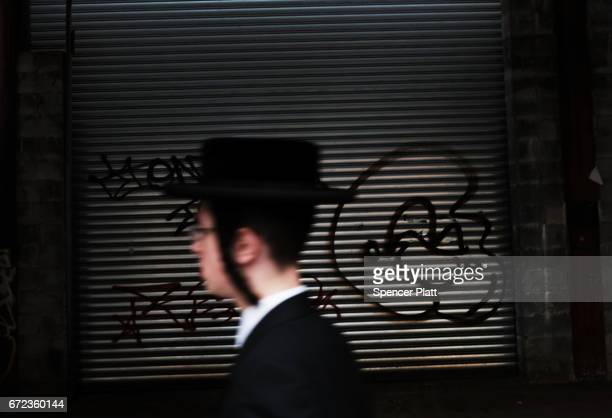Hasidic teen walks through a Jewish Orthodox neighborhood in Brooklyn on April 24 2017 in New York City According to a new report released by the...