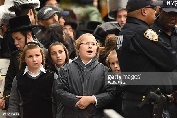 Hasidic youngsters watch from behind police/fire line Fire companies NYPD Red Cross and other emergency response personnel gathered in Borough Park...