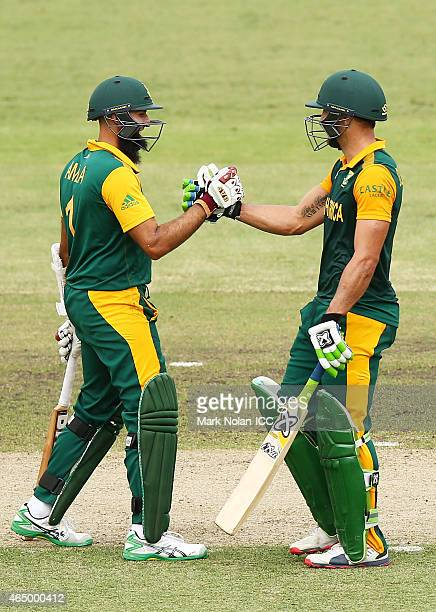 Hasim Amla of South Africa congratulates team mate Francois Du Plessis after Du Plessis scorined a century during the 2015 ICC Cricket World Cup...