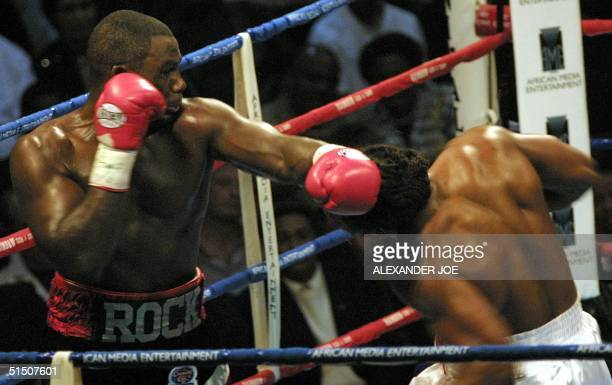 Hasim Rahman punches British World Heavyweight champion Lennox Lewis 21 April 2001, during their fight at the Carnival Areana, some 40 Kilometers...