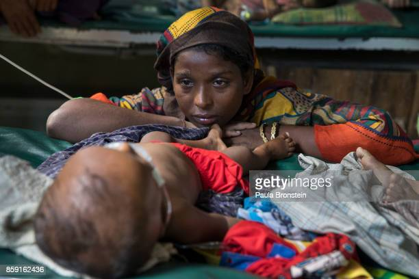 Hasina worries over her son Mohammed Anas11 months suffering from acute pneumonia in the pediatric neonatal unit at the 'Doctors Without Borders'...